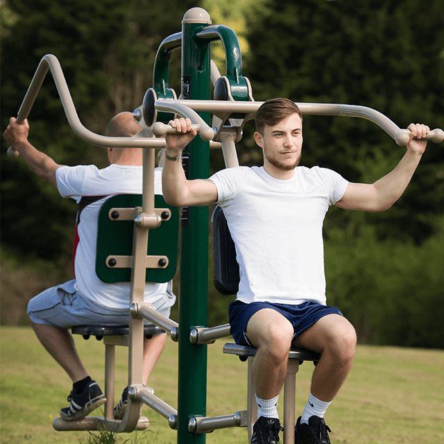 Two users making the most of our outdoor strength training equipment