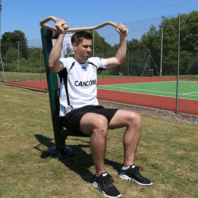 Outdoor Gym Equipment: Man using Fresh Air Fitness Resistance Shoulder Press in Outdoor Gym