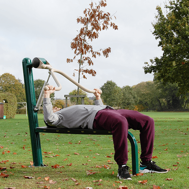 Man using Fresh Air Fitness Resistance Bench Press in Outdoor Gym