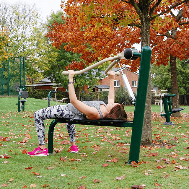 Lady using Fresh Air Fitness Resistance Bench Press in Outdoor Gym