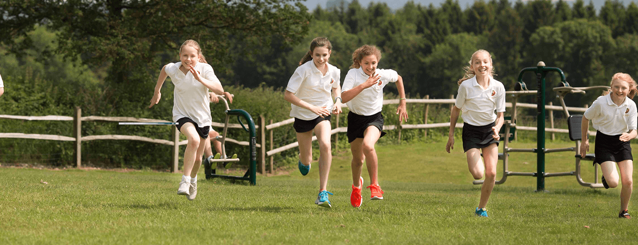 Children on outdoor gym equipment for secondary schools