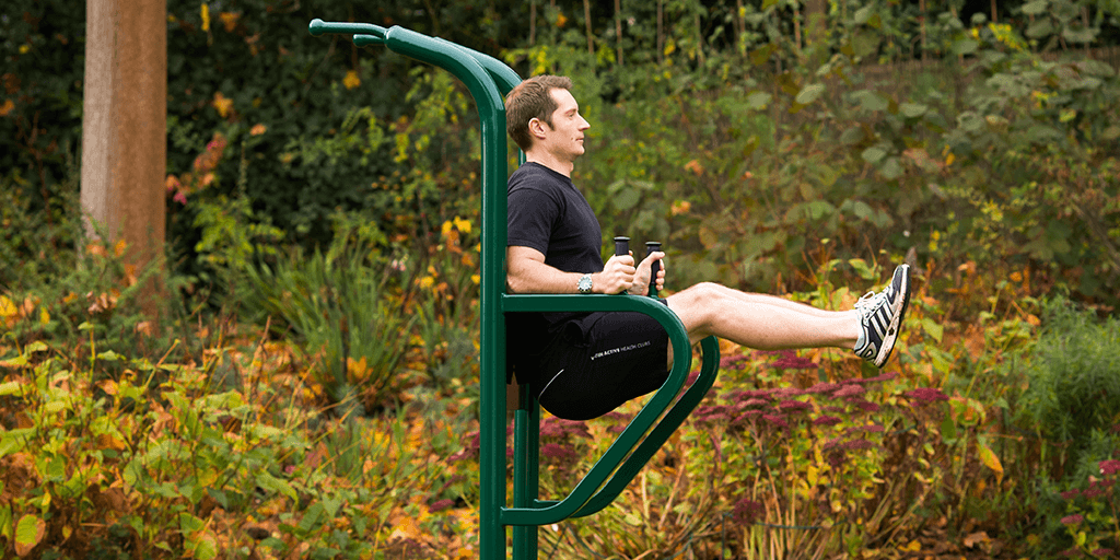 man performing leg raises on fresh air fitness leg lift station